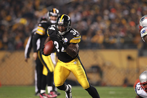 Rashard Mendenhall of the Pittsburgh Steelers runs the ball against the New England Patriots in a 2011 game. AP Photo/Tom Hauck