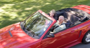 older couple in convertible