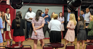Instructor Matt Higgins works with a team at the People's Improv Theater. (Photo courtesy Mac Gostow)